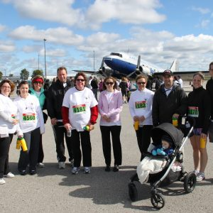 Ritchie Shortt & Tully LLP team with spouses, friends and family participated in the 2012 Hearth Place 5K on the Runway fundraising event.
